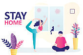 Stay home banner. Couple practices yoga,room interior. Couple sits at home on self-isolation, quarantine.