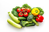 A tabletop arrangement of fresh vegetables multicolored, top view