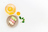 Japanese Dango dessert in pink, white and green colors, copy space