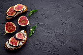 Canape or sandwich with figs and cheese, overhead view