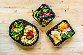Food delivery background. Take away meal in boxes. Top view