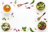 Herbal tea - green herbs and wild flowers, top view