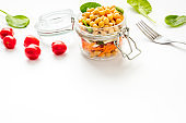Healthy vegan food. Chickpeas with vegetables in glass jar copy space