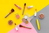 Flat lay of decorative cosmetics on color background. Above view