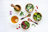 Layout of herbal tea with fresh summer herbs and wild flowers