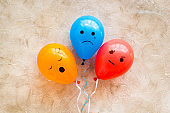 Negative emotions set. Anger depression sleepiness sadness mood painted on colored balloons