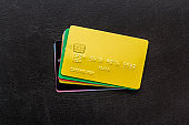 security concept. stack of credit card on black desk top-down