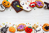 Frame of Halloween gingerbread cookies, top view