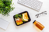 Call for delivery concept. Lunch boxes with meal on working place