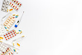Pharmacy - pills, tablets - flu, cold health care. on white background from above copy space