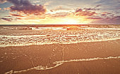 The beach with sunset and cloud in golden hours and sea water flow.