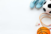 Sport games background - basketball, soccer ball, rackets, sneakers. Copy space