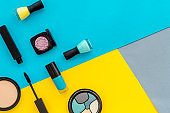Beauty cosmetics and makeup products on colorful background. Flat lay, top view