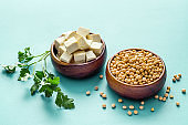 Tofu cubes with soybeans on blue kitchen table