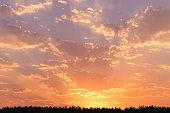 Cloudscape panorama over sunser sky.
