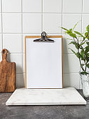 Kitchen background with clipboard with blank sheet for text