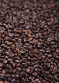 Fresh raw organic coffee beans top view background.