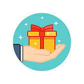Hand holding gift box decorated with a red bow on isolated white background. EPS 10 vector.