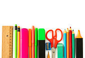 Colorful school stationery and supplies on white background