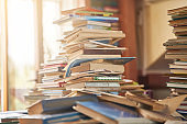 pile of old books on the table
