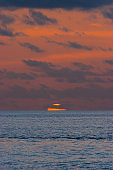 Sunset Over Sea With Moody Sky - Stock Photo