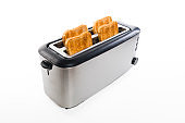 Toaster with crispy toastbread in front of white background