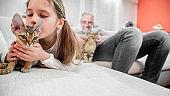 Happy Family Bonding with Devon Rex Cats - stock photo