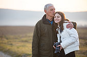 Grandfather and Granddaughter Enjoying in Rural Scene Together