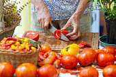 Senior Woman Chopping Tomatoes on Cutting Board