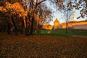 Veliky Novgorod, Russia. Autumn city landscape of Veliky Novgorod Kremlin framed by trees, sunset view