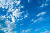 Blue sky background - white colorful sky clouds lit by sunlight