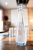 Close up glass water bottle on table