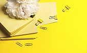 Business concept - Top view collection of light yellow fabric notebooks