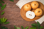 Snow pear or Korean pear on a wooden background, Nashi pear fruits delicious and sweet on wooden background