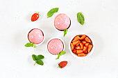 Strawberry ice cream scoop in bowl