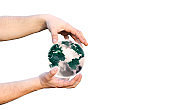 Man holding planet Earth in hands. Exhaust fumes pollution.  Environment protection. Save nature idea. Isolated on white background.