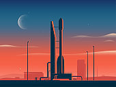 Vector illustration of a rocket spaceship at sunset preparing for launch