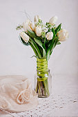 Bouquet of white tulips with lilac in vase