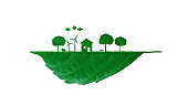 The house with turbine and solar cell clean energy object cutting green leaf.