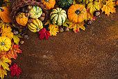 Decorated Autumn Thanksgiving Cornucopia on a Rustic Background