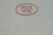 texture of a grayish cotton fabric with stamp special offer