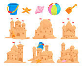 Sandcastles set and children toys bucket, seashell, scoop, starfish, ball. Sand palace, sculpture, tower.