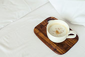 Cup of coffee on the bed