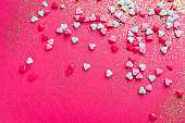 Valentine's Day background with red, pink and white little hearts