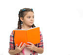 pupil with work book. back to school. literature and writing lesson. study homework. copy space. schoolgirl with notebook isolated on white. do homework. learning language. reading interesting story