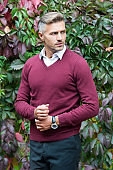 mature guy on autumn leaves background. fall business casual fashion. male fashion and beauty.