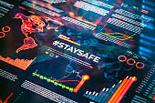 #staysafe. Stay safe hashtag close-up on digital display