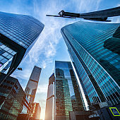 Corporate business buildings against blue sky
