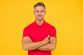 Confidence looks cool on him. Confident guy keep arms crossed yellow background. Barbershop. Hair salon. Casual style. Fashion trend. Mens wardrobe. Confident manner