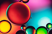 Abstract colourful bubbles of oil in water against bright vibrant background